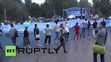 видео 1 мин. 2 сек. В Симферополе развернули самый большой в мире крымско-татарский флаг раздел: Новости, политика добавлено: 27 июня 2015